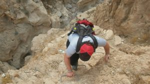 Person with autistic spectrum disorder climbing a mountain